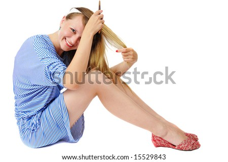 A pretty girl in stripy dress combing, isolated on white - stock photo