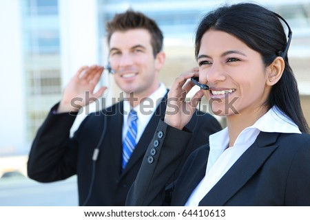 A pretty Indian customer service business woman and caucasian man at office building - stock photo