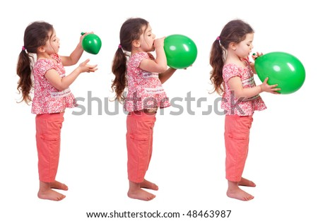 a pretty little girl blowing up a green balloon - stock photo