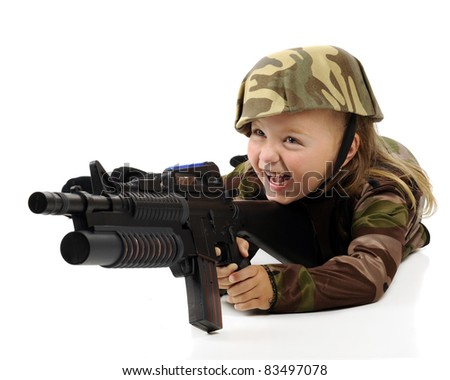 A pretty little girl having fun in a camouflage soldier's outfit while shooting a toy machine gun.  Isolated. - stock photo
