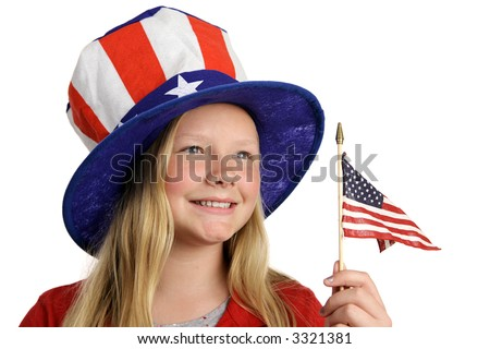 A pretty little girl in a patriotic American hat holding a flag and looking into the distance.