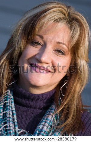 A pretty middle aged woman with a very sincere smile. - stock photo