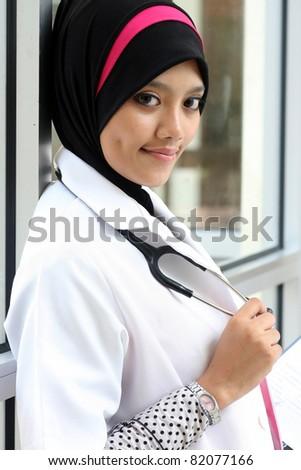 A pretty muslim woman doctor - stock photo