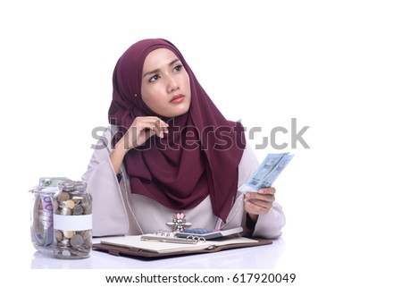 A pretty Muslim woman hold a money. Finance conceptual.