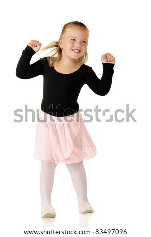 A pretty preschooler shaking to music in her ballerina outfit.  Isolated on white. - stock photo