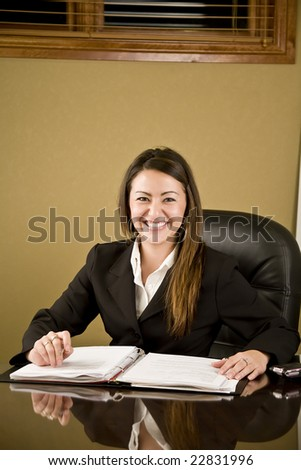 A pretty professional business woman working at her desk