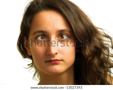 A pretty squint-eyed lady with brown hair - stock photo