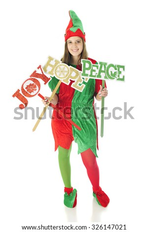 A pretty teen elf happily holding signs of Christmas wishes:  Joy, Hope and Peace.  On a white background. - stock photo