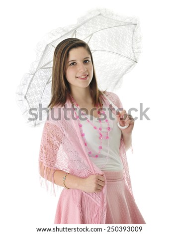 A pretty teen girl wearing strands of hearts, a pink shawl and carrying a lacy white parasol.  On a white background. - stock photo