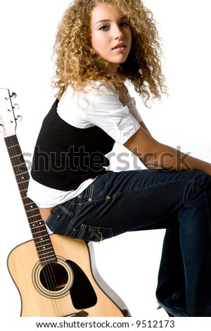 A pretty teenage girl with acoustic guitar