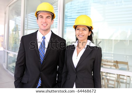 A pretty woman and handsome man architects on building construction site