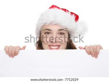 A pretty woman at Christmas holding a sign - stock photo
