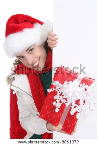 A pretty woman at Christmas holding her presents - stock photo