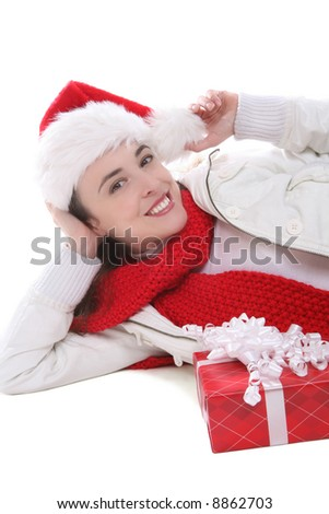 A pretty woman at Christmas laying next to presents
