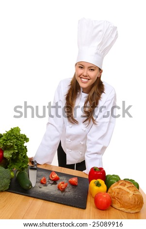 A pretty woman chef in the kitchen preparing food - stock photo