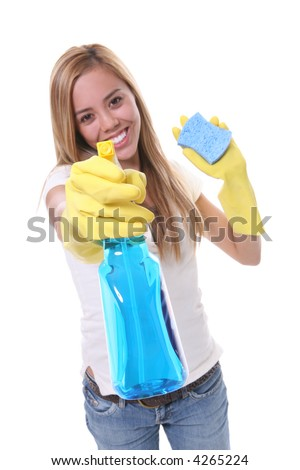 A pretty woman cleaning with spray and sponge - stock photo