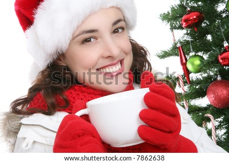 A pretty woman drinking coffee during Christmas - stock photo