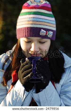 A pretty woman drinking hot drinks outdoor