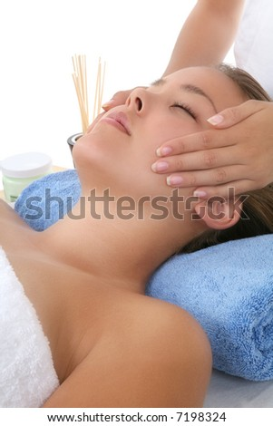 A pretty woman getting a massage at the spa - stock photo