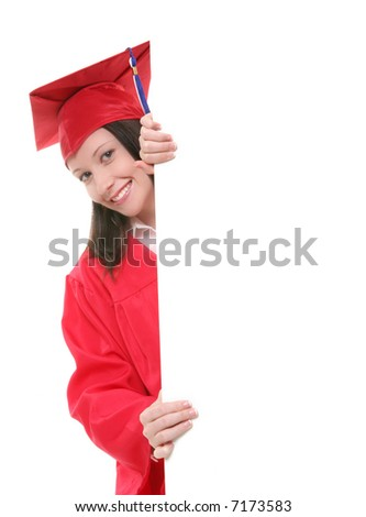 A pretty woman graduate holding a blank sign - stock photo