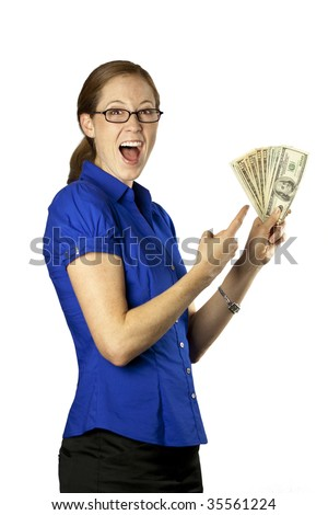 A pretty woman holding and pointing at a money fan - stock photo