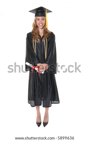 A pretty woman holding her diploma at graduation - stock photo