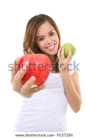 A pretty woman holding two colorful ripe apples - stock photo