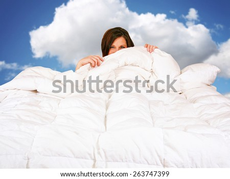 a pretty woman in a big bed with white  - stock photo