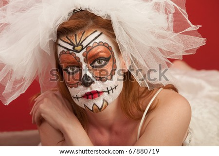 A pretty woman in a wedding dress and makeup for All Souls Day - stock photo