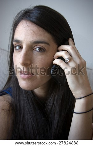 A pretty woman is talking on a cell phone
