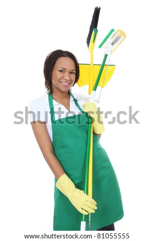 A pretty woman maid cleaner holding broom, pan, and mop - stock photo