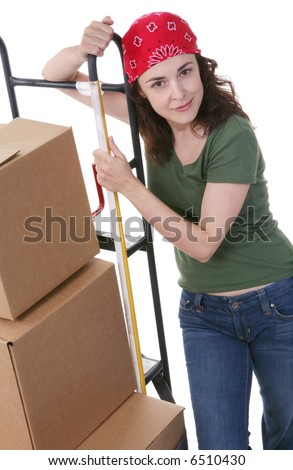 A pretty woman moving and shipping using a two wheel push cart - stock photo