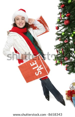 A pretty woman shopping at Christmas holding sale bags - stock photo