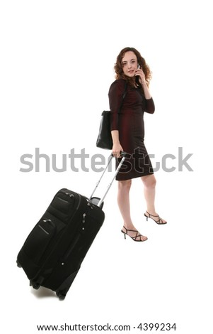 A pretty woman traveler with suitcase on the phone