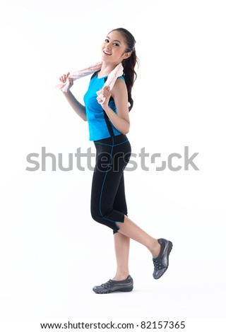 A pretty woman walking for exercise - stock photo