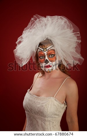 A pretty woman with bridal wear and Day of the Dead make-up - stock photo