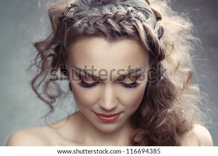 A pretty woman with curly hair - stock photo