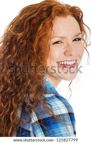 A pretty woman with red hair and a beautiful smile - stock photo