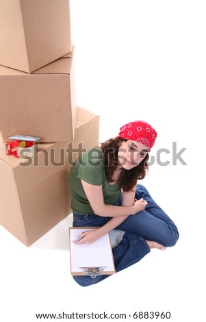 A pretty woman working packing her shipment - stock photo