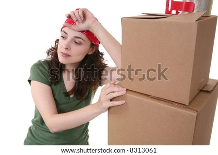 A pretty woman working with moving and shipping boxes - stock photo
