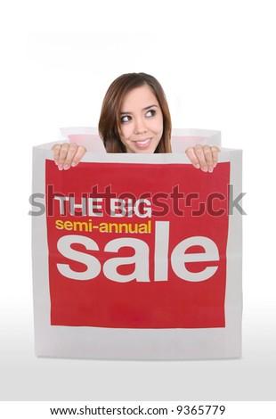 A pretty women inside a shopping sale bag - stock photo