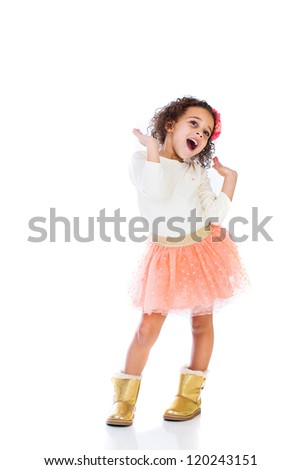 A pretty young African American girl having fun showing her sassy attitude. - stock photo