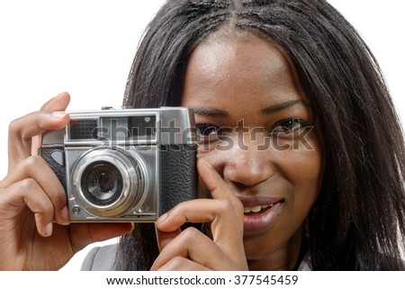 a pretty young African American with an old camera