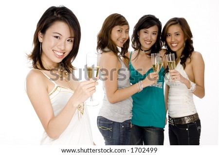 A pretty young asian woman drinks champagne with friends stood behind