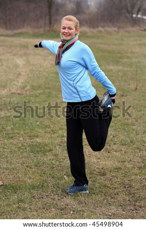 A pretty young girl before running make gymnastics - stock photo