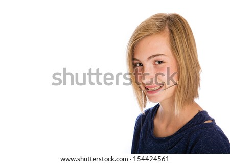 A pretty young girl wearing dental headgear - stock photo