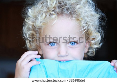 a pretty young girl wigh gorgeous blue eyes and curly blonde hair - stock photo