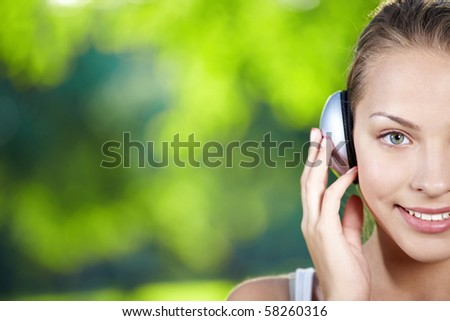 A pretty young girl with headphones - stock photo