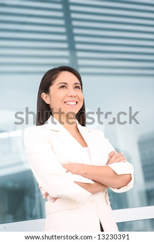 A pretty young hispanic woman outside her school university - stock photo