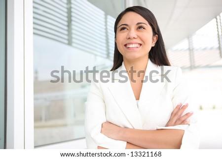 A pretty young hispanic woman outside her school university - stock photo